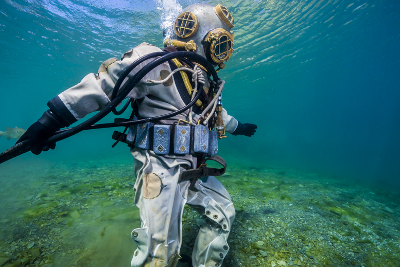 """I leapt out of the car and produced an image of my dive buddy, Ben Castro, descending down a slope while donning a Mark V diving helmet and suit."" © Jennifer Idol"