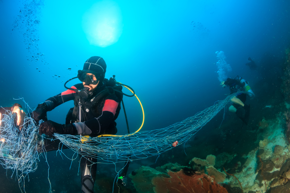 Divers removing ghost nets from the ocean