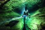 Diver with a rebreather in the Molnár János Cave, a thermokarstic water-filled cave system located in the Rózsadomb district of Budapest in Hungary, Europe. The deepest sections reach 98 metres (320ft), while the total length of explored sections is currently 7 kilometres (4.3miles). Cave mouth is just 200 metres (660ft) from Danube.